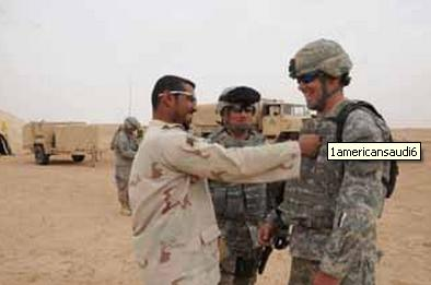 An Arab Saudi soldier jokes with a US soldier